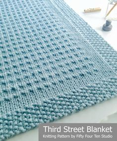 Third Street Blanket knitting pattern by Fifty Four Ten Studio.  Knit with super bulky yarn.  Very easy pattern.  Instructions for five sizes.  Afghan - Throw - Crib - Baby