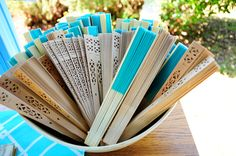 We gave out custom imprinted tiffany blue colored fans to wedding guest to help them keep cool on a warm Texas summer day. The fans were printed with our names and wedding date.