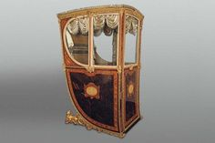 "Royal Workshops, ""Sedan Chair of Queen María Luisa of Parma"", 1795. Wood, gilded metal, bronze, velvet and silver, 163 x 78 x 100 cm. Madrid, Royal Palace, National Heritage"