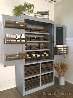 Build a freestanding pantry || This has a great neutral color and just the right amount of rustic with the crate wood, but I would probably do dark stained wicker baskets below, or make two taller shelves for wicker waste baskets or recycling