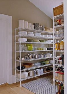 Ina's Barn Kitchen - House Beautiful The Pantry In the pantry, simple wire Metro shelving holds plates, props, and supplies. Read more: Barefoot Contessa - Barn - Ina Garten - House Beautiful Kitchen Organization Pantry, Pantry Storage, Kitchen Shelves, Kitchen Storage, Kitchen Decor, Organized Pantry, Pantry Ideas, Storage Shelves, Storage Ideas