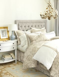 With classic elements like toile bedding and a tufted headboard, this bedroom feels classic but interesting