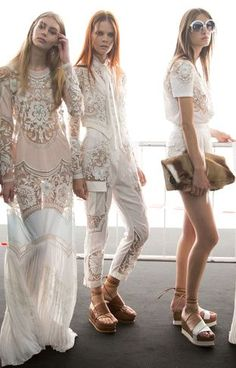 Roberto Cavalli Spring 2015 backstage only like what model in middle is wearing