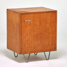 George Nelson; Oak and Aluminum Cabinet for Herman Miller, 1950s.