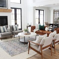 Interior Design Trends on the Rise in 2019 neutral meets traditional living room decor, neutral living room design with wood and upholstered armchair and fireplace decor, leather sofa in open floor plan family room design Family Room Decorating, Family Room Design, Decorating Ideas, Decor Ideas, Interior Design Living Room, Living Room Designs, Interior Design Trends, Design Ideas, Home Design