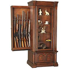 @Overstock.com - Eight-gun cabinet displays most 52-inch scoped rifles  Display includes felt-lined gun barrel rest and butt plate  Cabinet features sliding gun storage behind curio display areahttp://www.overstock.com/Sports-Toys/Kodiak-Eight-Gun-Storage-Cabinet-with-Lighted-Curio-Display/4667853/product.html?CID=214117 $755.99