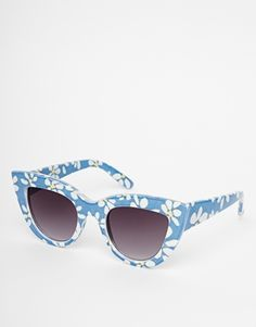 These blue sunnies give off a great retro vibe, the shape and colours would look great with some red lipstick. http://asos.to/1A7PKa4