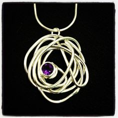 Silver and amethyst wrap necklace by abby filer jewellery. £85