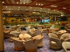 """Spotlight Lounge (Deck 6): A large secondary theater all the way at the back of the ship on Deck 6, the Spotlight Lounge is regularly used for activities such as bingo, art seminars and auctions and interactive game shows (""""Majority Rules,"""" """"Family Feud,"""" """"The Quest""""), but it's at its busiest between 8:30 and 10:30 p.m. every night when the karaoke gets started. It's usually standing room only and the crowd definitely gets into singing along and even dancing when appropriate. Aruba Cruise, Enchantment Of The Seas, Celebrity Summit, Southern Caribbean Cruise, Freedom Of The Seas, Harbor Town, Bridgetown, Family Feud, Island Tour"""
