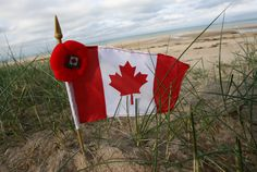 A Canadian flag is seen near Juno Beach during ceremonies to honor Metis veterans of WWII, at Juno Beach Center, near Caen, Normandy, Wednes...