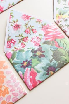 floral envelopes-take apart regular envelope for pattern. cut out two using one sided scrapbook paper. Trim one slightly smaller than first. Fold smaller one inside out and glue the two together.