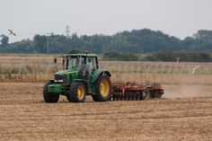 John Deere 6920s tractor & disc harrow, UK farming Photography, stock