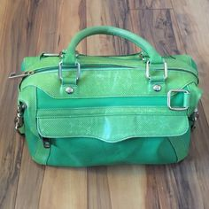 """Rebecca Minkoff Green Leather Purse Authentic Rebecca Minkoff Green Leather Purse. Gold accents and buckles. Interior is navy and cream color with one zip pocket and 2 large open pockets. Purse has zip closure with one outside, large zip pocket. Bag shows some signs of typical wear. Bag measures 12.5""""L x 8""""H x 7""""W (can expand to wider). Strap drop approx 8"""". Great bag! Rebecca Minkoff Bags"""