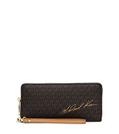 c608b4758889 Designed with our subtle logo motif, this timeless wallet features plenty  of pockets and slots inside for easy organization. Michael's signature ...
