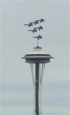The Blue Angels Show is a popular feature of the annual Seattle Seafair Celebration as seen in this photo as they fly by the Seattle Space Needle.