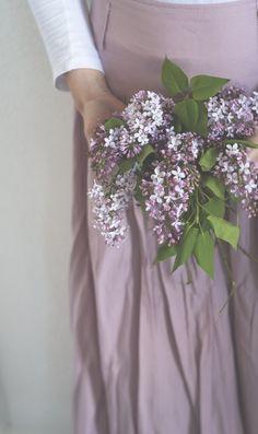 Woman holding lilacs
