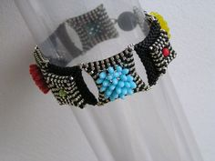 Bracelet Chrysanthemid ( Mikki Ferrugiaro) -- Uses Rizo beads in the center of some components for dimension.