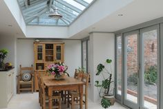 Simple and elegant wooden orangery by Clifton Joinery.