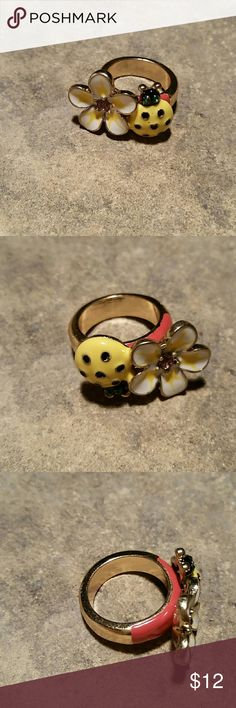 Flower & Ladybug Heart Enamel & Crystals Ring New, never worn. Sweet & sexy enameled flower  flower & lady bug cocktail ring. A white flower with pink crystal in the center, and yellow & black ladybug with a heart shape in the center, green crystal rhinestone eyes, all bordered in shiny gold. The top edges of the ring band are bright salmon pink. Looks designer, I don't know who. Size 7.  Matching Flower ring also available in my closet!  Thank you for visiting my closet, and happy poshing…