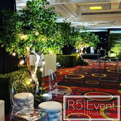Corporate event decor with green hedge, tall green trees, beautiful lighting - by Event Design Event Photo Booth, Wedding Decorations, Table Decorations, Ceiling Decor, Trees Beautiful, Green Trees, Decorating On A Budget, Hedges, Event Decor