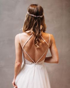 Our favorite emerging bridal trend? The return of spaghetti straps! Theyre romantic fashion-forward and make a stunning back statement. @livvylandblog embraced the trend at her recent #BHLDNhouston appointment slipping into the Rosalind Gown to snap a pic. (photo by @kayrahhhhh | link in profile to shop) by bhldn