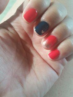 Deep coral and navy nails