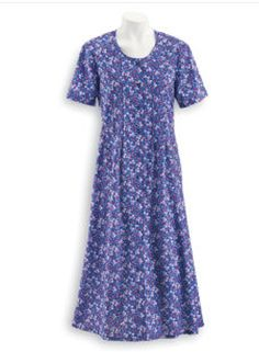 "Allover mini-floral print dress features a tucked bodice that releases to soft pleats. Button front, side-seam pockets, and back ties. 100% woven cotton. Machine wash. Imported. S–XL, 49"" long; 1X–3X, 51"" long."