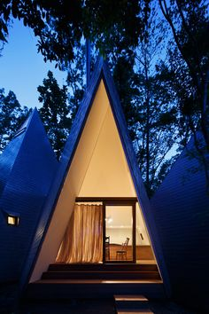 This woodland home was designed to resemble a cluster of timber tepees.
