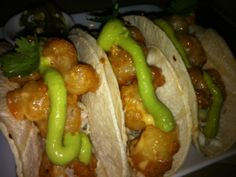 Ravenous Pig Tacos: fernandina beach rock shrimp with cilantro, avocado, pickled jalapeño, cabbage slaw.