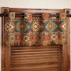 The rustic, polyester Canyon Ridge Grommet Window Treatments evoke the spirit of the Southwest. Grommet Curtains are saddle brown, faux suede.