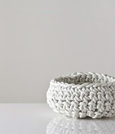 """Neo's crocheted baskets are made of neoprene rubber, a material which is used frequently in plumbing and the motorcycle industries. $89 at  ahref=""""http://www.dwell.com/%3Ca%20href%3D""""http://www.gretelhome.com/neo/315-large-crocheted-rubber-bowl-in-white.html"""">http://www.gretelhome.com/neo/315-large-crocheted-rubber-bow...""""Gretel Home."""