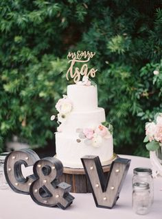 Mr. and Mrs. gold topped three tier wedding cake: http://www.stylemepretty.com/california-weddings/san-juan-capistrano/2016/09/23/old-world-elegance-meets-garden-romance/ Photography: Sposto - http://spostophotography.com/