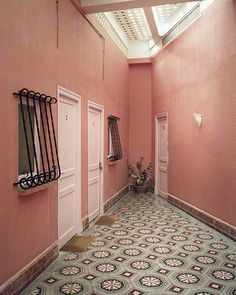 Washed out rose colored walls + patterned floor tile = perfect.