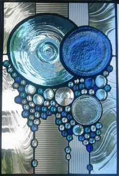 Circles Swirls. GORGEOUS!@Leigh Bardell I have stained glass making stuff. I wonder if I could do this with melted bottle bottoms. - Interiors Inspired