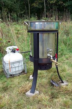 Make a large-volume, propane, camp water heater that dispenses hot water like a kitchen faucet.