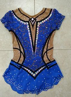 Competition rhythmic gymnastics leotard for 10,11,12 years old girl. Baton twirling costume (dress) For 142-152 cm height, Not stretched measurements: chest 62 cm, waist 52cm, hips - 66 cm, torso 114 (up to 130 cm). Design visually makes the figure beautiful. Preziosa crystals make it