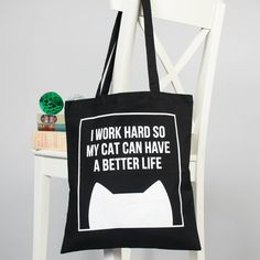 The perfect cat tote bag to tell everyone that you work hard for your cat. A lovely gift for mum on Mother's Day or a treat for yourself.The design is screen printed in white on the 100% cotton black bag which allows it to really pop and be bold for everyone to see. The handles are nice and long so y