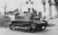 German soldier watching abandoned Polish TK-S tanktette. Main armament, which was machine gun, was dismounted. September 1939