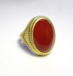 Carnelian Ring - A stylized 18kt gold ring with a cabochon but carnelian stone. K409065 (subject to prior sale) – Lilliane's Jewelry – 4101 W. 83rd St. Prairie Village, KS 66208 – 913-383-3376 –