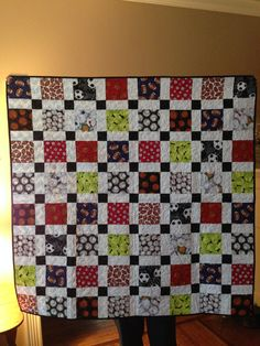 This is a Disappearing Nine Patch pattern that I made for my great nephew Jax.  He loves balls!