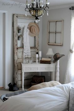 Love this vintage/shabby chic/rustic white room. Everything is so appealing, especially the old door and window frame. Hang an old window frame instead of art. Love the chandelier. Sincerely, JoAnne Craft