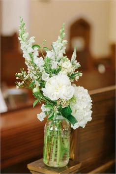 Mason jar floral arrangements to add decor to a traditional church ceremony setting. Floral Design: Ashley Elaine ---> www. Mason Jar Flower Arrangements, White Floral Arrangements, Mason Jar Flowers, Beautiful Flower Arrangements, Wedding Flower Arrangements, Table Flowers, Flower Bouquet Wedding, Floral Wedding, Beautiful Flowers