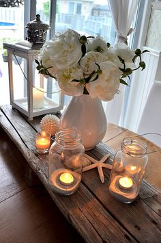 Beach wedding idea - simple.  Love the wood, jars, sand and accessories.  Not a huge fan of these particular flowers or the vase.