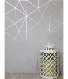 This Metro Prism Geometric Triangle Wallpaper in Grey and Silver features stylish metallic elements. Part of the World of Wallpaper Metro Collection. Free UK delivery available. Geometric Wallpaper Living Room, Geometric Triangle Wallpaper, Grey Bedroom Wallpaper, Wallpaper Lounge, Silver Bedroom, Gray Bedroom, Grey Family Rooms, Feature Wall Living Room, Bedroom Wall Colors
