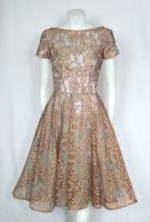 VINTAGE 1950s Blue & Bronze Illusion Lace Party Dress from Vintage a la Mode on 1stdibs ($475). Too retro?  Too beige?