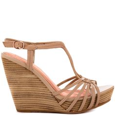 Let the force be with you every step taken in the Gale Force.  This simple Seychelles style features a light beige leather upper with unique vamp and adjustable t-strap.  Finishing this dainty style is a stacked 4 1/2 inch wedge and 1 inch platform.