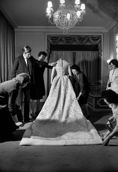 Yves Saint Laurent putting the finishing touches on Farah Diba's wedding dress, 1959.
