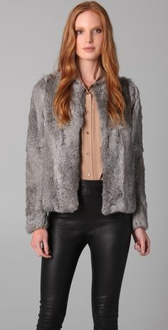Match a gray fur coat with a camel silky top and black leggings