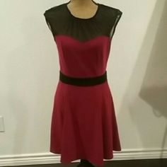 Red dress with black details and sheer mesh NWOT This piece features: - Sweetheart neckline - Princess lines on just and skirt - Button on back with slit down last to the zipper - Flattering black band in waist - Striking silhouette Paper Doll Dresses
