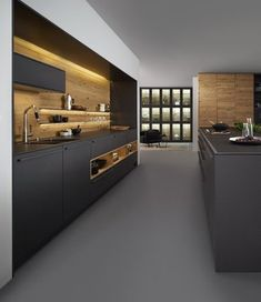 The BONDI | VALAIS by the Leicht Kitchen Design Centre is a premium carbon grey kitchen married with light wood to compliment and accent the modern kitchen ideal.